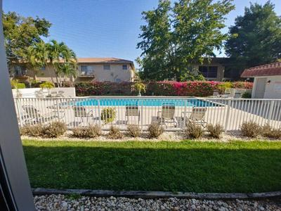 8605 W SAMPLE RD APT 104, Coral Springs, FL 33065 - Photo 2