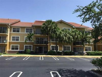 8741 WILES RD APT 102, Coral Springs, FL 33067 - Photo 1