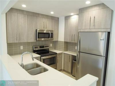 290 W PALMETTO PARK RD APT 309, Boca Raton, FL 33432 - Photo 1