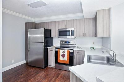 8761 WILES RD APT 202, Coral Springs, FL 33067 - Photo 2
