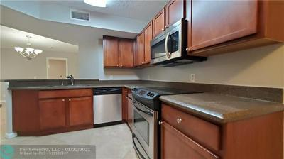 8701 WILES RD APT 207, Coral Springs, FL 33067 - Photo 2