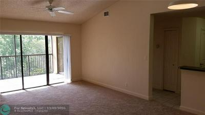 10155 W SUNRISE BLVD APT 302, Plantation, FL 33322 - Photo 2