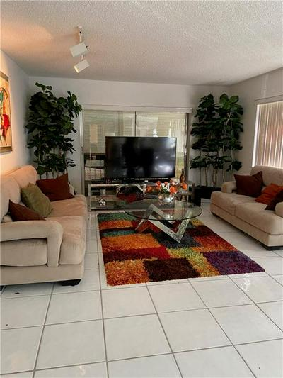 6061 N FALLS CIRCLE DR APT 101, Lauderhill, FL 33319 - Photo 1