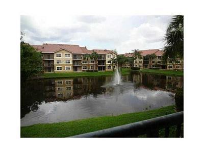 8741 WILES RD APT 102, Coral Springs, FL 33067 - Photo 2