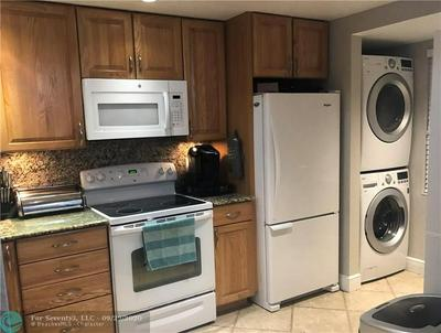 400 COMMODORE DR APT 103, Plantation, FL 33325 - Photo 2