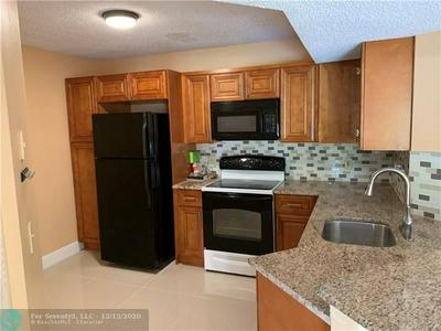 8891 WILES RD APT 204, Coral Springs, FL 33067 - Photo 2