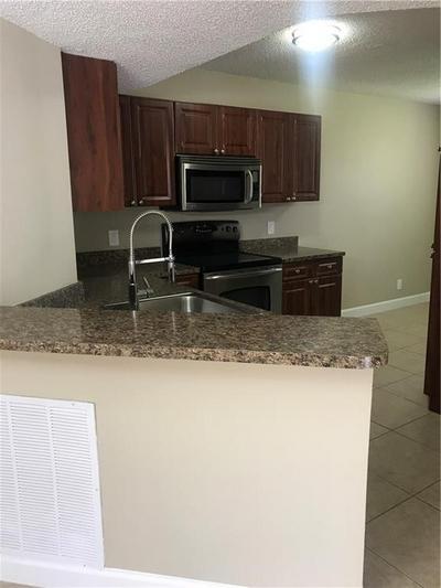 8901 WILES RD APT 208, Coral Springs, FL 33067 - Photo 2