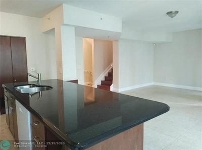 6966 W SAMPLE RD, Coral Springs, FL 33067 - Photo 1