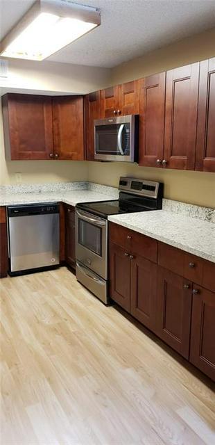 8851 WILES RD APT 207, Coral Springs, FL 33067 - Photo 1