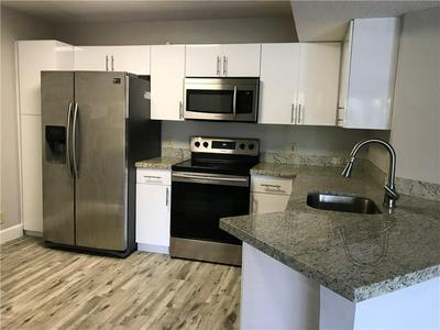 8955 WILES RD APT 204, Coral Springs, FL 33067 - Photo 1