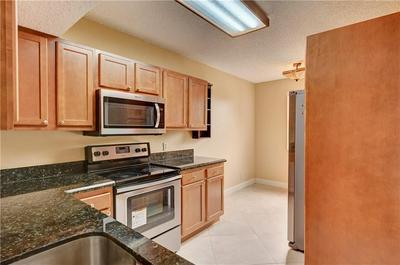 8701 WILES RD APT 302, Coral Springs, FL 33067 - Photo 2