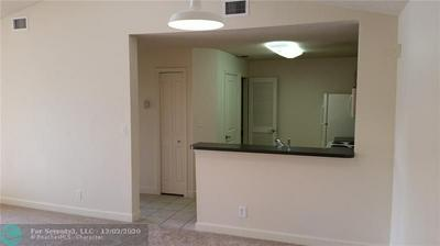 10155 W SUNRISE BLVD APT 302, Plantation, FL 33322 - Photo 1