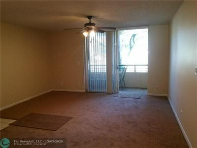 641 LYONS RD APT 11108, Coconut Creek, FL 33063 - Photo 2