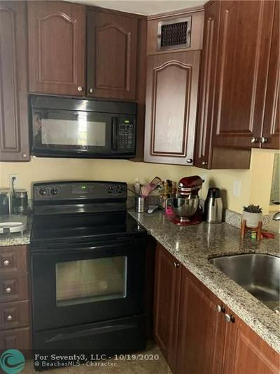 405 GARDENS DR APT 101, Pompano Beach, FL 33069 - Photo 1
