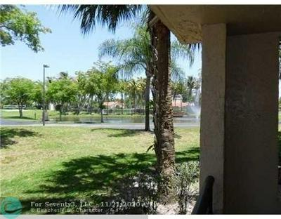 701 LYONS RD APT 13101, Coconut Creek, FL 33063 - Photo 2