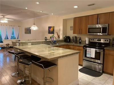 5900 W SAMPLE RD APT 301, Coral Springs, FL 33067 - Photo 1
