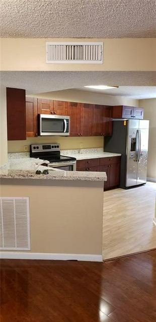 8851 WILES RD APT 207, Coral Springs, FL 33067 - Photo 2