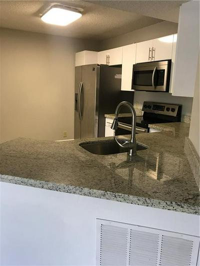 8955 WILES RD APT 204, Coral Springs, FL 33067 - Photo 2