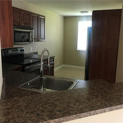 8901 WILES RD APT 208, Coral Springs, FL 33067 - Photo 1