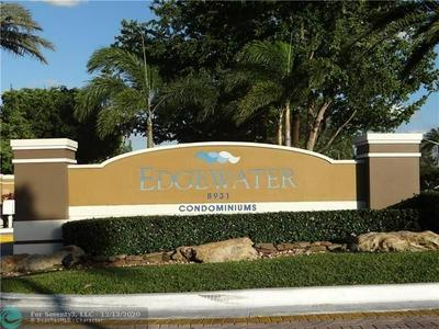 8891 WILES RD APT 204, Coral Springs, FL 33067 - Photo 1