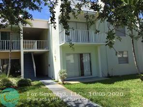 407 EXECUTIVE CENTER DR APT 110, West Palm Beach, FL 33401 - Photo 1