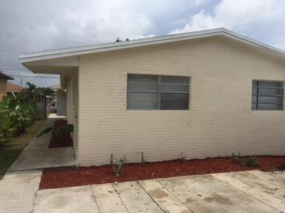 704 NW 4TH ST 1, Hallandale, FL 33009 - Photo 1