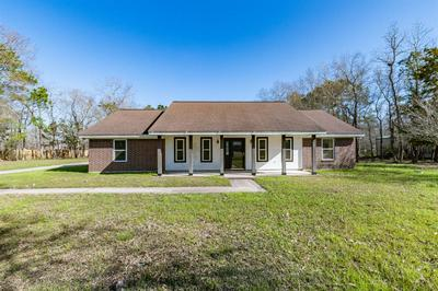 228 COMMANCHE TRL, Wallisville, TX 77597 - Photo 1