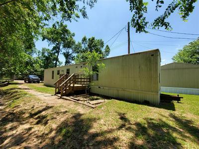 401 S WOODSON ST APT 11, Willis, TX 77378 - Photo 1