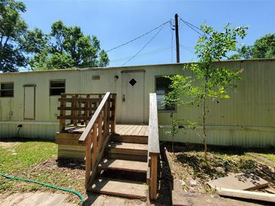 401 S WOODSON ST APT 11, Willis, TX 77378 - Photo 2