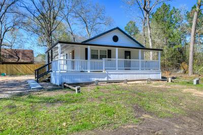 21 CEDAR LODGE RD, COLDSPRING, TX 77331 - Photo 1