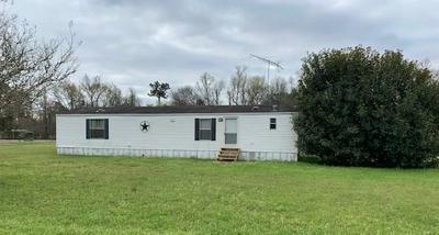 184 WOOD FERN DR, CLEVELAND, TX 77327 - Photo 1