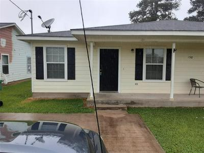 150 S BEND CT # A, Willis, TX 77378 - Photo 1