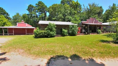 124 COMMERICAL AVE, COLDSPRING, TX 77331 - Photo 1
