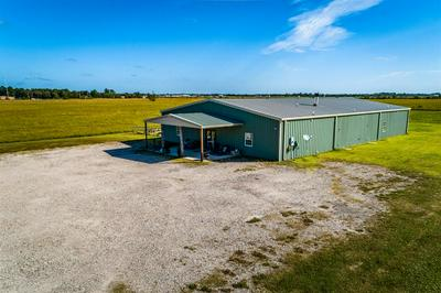 1221 ROSS STERLING AVE, ANAHUAC, TX 77514 - Photo 1