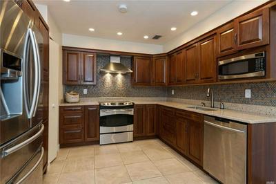 49 CARRIAGE HOUSE DR, Jericho, NY 11753 - Photo 2