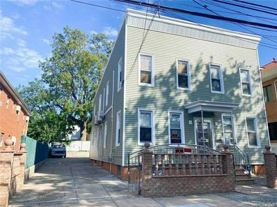 18-31 124TH ST, College Point, NY 11356 - Photo 1