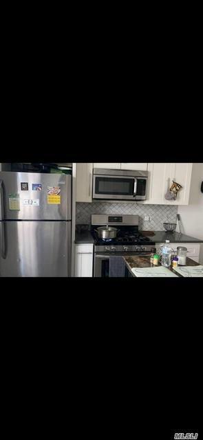 98-17 32ND AVE, Flushing, NY 11369 - Photo 2