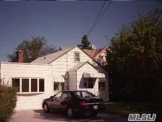 332 WANSER AVE, Inwood, NY 11096 - Photo 1