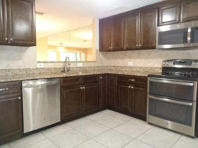 9105 TUDOR DR APT 203, TAMPA, FL 33615 - Photo 2