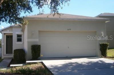 1077 SINGLETON CIR, Groveland, FL 34736 - Photo 1