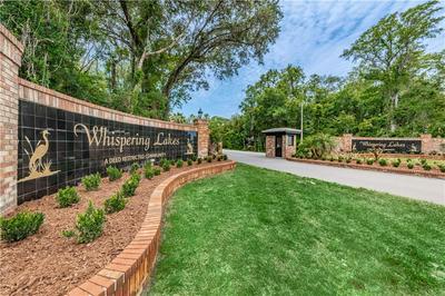 574 WHISPERING LAKES BLVD, Tarpon Springs, FL 34688 - Photo 2