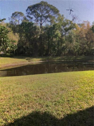1801 E LAKE RD APT 14D, Palm Harbor, FL 34685 - Photo 1
