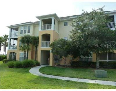 9401 CRESCENT LOOP CIR APT 203, TAMPA, FL 33619 - Photo 1