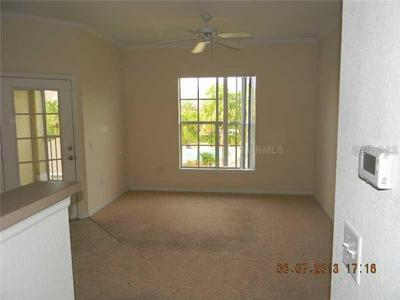 9404 CRESCENT LOOP CIR APT 306, TAMPA, FL 33619 - Photo 2