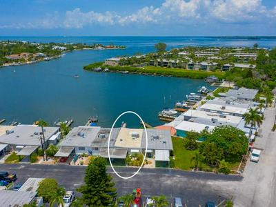 13 SEASIDE CT, Holmes Beach, FL 34217 - Photo 1