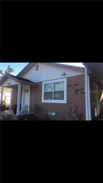 8309 N MULBERRY ST, TAMPA, FL 33604 - Photo 1