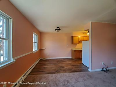 14 WINDSOR TER APT G, Freehold, NJ 07728 - Photo 1