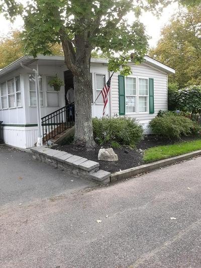 32 VILLAGE RD, Morganville, NJ 07751 - Photo 1