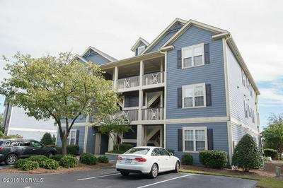 2555 ST JAMES DR UNIT 105, SAINT JAMES, NC 28461 - Photo 1