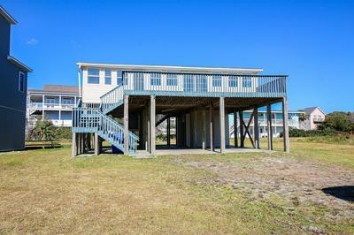 7604 E BEACH DR, Oak Island, NC 28465 - Photo 1